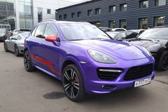 Moscow. Autumn 2018. Blue purple striped with red Porsche Cayenne E2 stands on parking. Wrapped vinyl film.  royalty free stock image