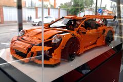 Moscow. Autumn 2018. The original Lego Porsche 911 Gt3 RS at the Porsche dealership. orange sports car from the designer stock image