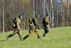 Moscow battle historical reenactment. Running reenactors soldiers. Stock Images