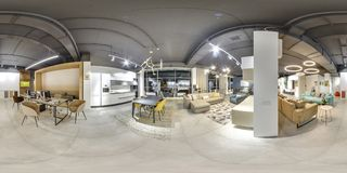 Moscow - 2018: Beautiful fashionable interior of furniture design store in modern mall with loft interior. Concrete floor with dar. K gray ceiling. Cream color Royalty Free Stock Images