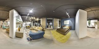Moscow - 2018: Beautiful fashionable interior of furniture design store in modern mall with loft interior. Concrete floor with dar. K gray ceiling. Cream color Royalty Free Stock Photography