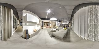 Moscow - 2018: Beautiful fashionable interior of furniture design store in modern mall with loft interior. Concrete floor with dar. K gray ceiling. Cream color Royalty Free Stock Photo