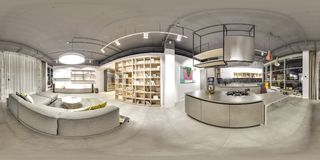 Moscow - 2018: Beautiful fashionable interior of furniture design store in modern mall with loft interior. Concrete floor with dar. K gray ceiling. Cream color Stock Photos