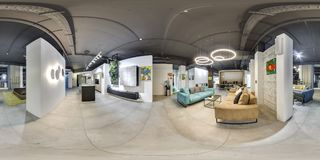 Moscow - 2018: Beautiful fashionable interior of furniture design store in modern mall with loft interior. Concrete floor with dar. K gray ceiling. Cream color Royalty Free Stock Image