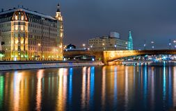 Moscow cityscape night. Moscow, bridge over the Moskva river in Moscow by a winter night with illumination from streetlight reflected in water as a foreground Stock Image