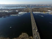 Moscow Bridge across Dnepr River,. Photo from drone at winter. February 18, 2019. Kiev,Ukraine royalty free stock images