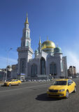 Moscow Cathedral Mosque. View at the Moscow Cathedral Mosque, the main mosque in Moscow, landmark. In the foreground a car Taxi stock image
