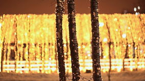 Moscow. Christmas decorations on tree trunks. Night city in Christmas illumination. Sparkling lights. Walking passers-by stock footage