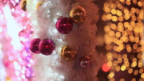 Moscow. Christmas. Toys-balls in white festive splendor, scenery from garlands and lights of illuminations on a city stock footage