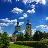 Moscow. The Church of the apostles Peter and Paul in Yasenevo. The Church of the bright sun. Blue sky with highlighted clouds. Around the Church a lot of green Royalty Free Stock Photo