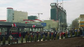 MOSCOW - CIRCA APRIL, 2018: Crowd of people waiting for opening new metro station. Crowd of people waiting for opening new metro station in Moscow stock video footage