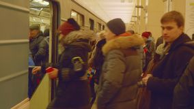 Moscow - circa April, 2018: People entering carriage of train in subway. People entering carriage of train in new metro station stock video footage