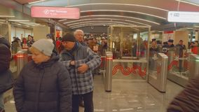 Moscow - circa April, 2018: People go through turn gates in new metro station. People go through turn gates in new metro station in Moscow stock footage