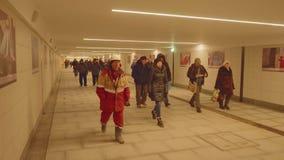 MOSCOW - CIRCA APRIL, 2018: People walk in tunnel of new metro station Seligerskaya. People walk in tunnel of new metro station Seligerskaya in Moscow stock video