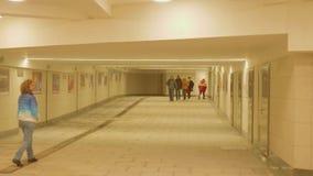 MOSCOW - CIRCA APRIL, 2018: People walk in tunnel of new metro station Seligerskaya. People walk in tunnel of new metro station Seligerskaya in Moscow stock footage