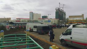 MOSCOW - CIRCA APRIL, 2018: View of cars and crowd of people waiting for copening of new metro station. View of cars and crowd of people waiting for copening of stock video footage
