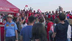 Moscow - Circa June, 2018: Group of Fan from Tunisia On Manezhnaya square in Mosocw. Group of Fan from Tunisia On Manezhnaya square stock video