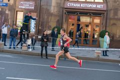 Moscow city autumn marathon. Moscow - September 24, 2017: Participants of Moscow autumn marathon sponsored by Asics brand royalty free stock image