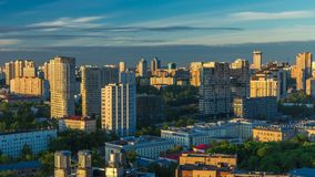 Moscow city bathed in yellow sun at dawn timelapse. An early foggy morning. Shadows moving on houses. Megalopolis aerial stock footage