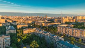 Moscow city bathed in yellow sun at dawn timelapse. An early foggy morning. Shadows moving on houses. Megalopolis aerial stock video