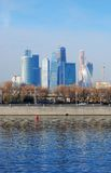 Moscow City business center. View from the Moscow river embankment. Blue sky background Royalty Free Stock Photo