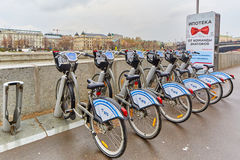 Moscow - 10.04.2017: City bycicle parking lot near the river, Mo Stock Images