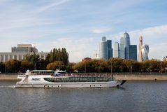 Moscow City Center. Cruise ship sails along the buildings. Stock Photo