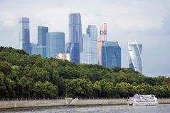 Moscow City Center. Cruise ship sails along the buildings. Royalty Free Stock Photos
