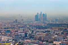 Moscow City and cityscape in smog autumn day. Above view on Moscow City and cityscape in smog autumn day, Russia Royalty Free Stock Images