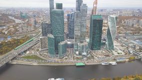 Moscow-City. Clip. Russia. Grandiose skyscrapers on the waterfront near the Moscow river. The Evolution tower is a. Masterpiece of architecture. Tower Empire Stock Photo