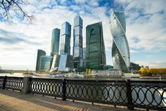 Moscow City Complex Of Skyscrapers On Embankment Of Moskva River. Modern Buildings Of Moscow City Complex Of Skyscrapers On Dramatic Sky Background On Embankment Stock Image