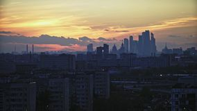 Moscow-City on the horizon at sunset. View from a tall residential building. timelaps stock footage