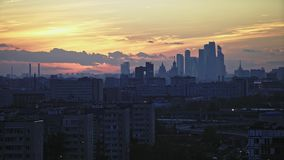 Moscow-City on the horizon at sunset. View from a tall residential building. Zoom in. ColorCorr stock video