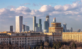 Moscow city and modern Moscow architecture beyond the chemistry faculty of Moscow State University built in Stalin epoch Stock Images