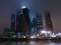 Moscow city night mist. Modern contemporary city architecture: Moscow City commercial center by night in mist and fog illuminated. Includes skyscreper buildings Royalty Free Stock Photography