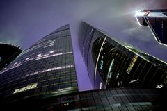 Moscow City skyscrapers Federation Towers and Mercury City Tower at misty beautiful night. Royalty Free Stock Photo