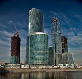 Moscow city skyscrapers on the river bank. Under the cloudy sky Stock Photography