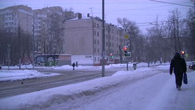Moscow city winter traffic Time-lapse. The movement of vehicles and pedestrian traffic in Russia in winter. Time-lapse from street in the East district of Moscow stock footage