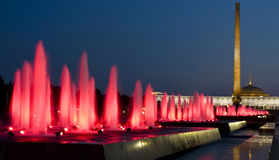 Moscow, coloured fountains. And Historical museum of Second World War in cultural centre Poklonnaya hill on Kutuzovskiy prospectus avenue at night royalty free stock images