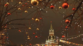 Moscow is decorated for New Year and Christmas holidays. Christmas balls on the branches of trees near the Cathedral of. St. Basil the Blessed on Red Square New stock video