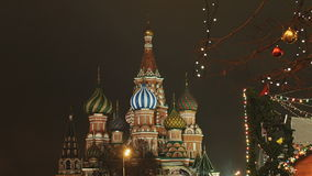 Moscow is decorated for New Year and Christmas holidays. Christmas balls on the branches of trees near the Cathedral of. St. Basil the Blessed on Red Square New stock footage