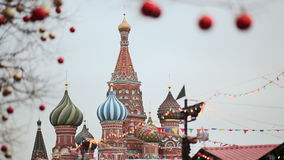 Moscow is decorated for New Year and Christmas holidays. Christmas balls on the branches of trees near the Cathedral of. St. Basil the Blessed on Red Square New stock video footage