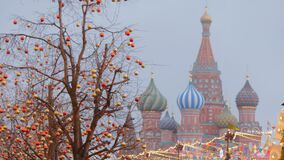 Moscow is decorated for New Year and Christmas holidays. Christmas balls on the branches of trees near the Cathedral of St. Basil the Blessed on Red Square stock video footage
