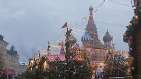 Moscow is decorated for New Year and Christmas holidays. Christmas balls on the branches of trees near the Cathedral of St. Basil the Blessed on Red Square stock video
