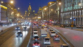 Moscow. Evening traffic. Cars on the road out of the tunnel in the city center. stock footage