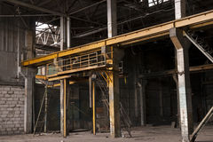 Moscow factory during demolition. Empty factory in Moscow during demolition with machinery removed and remaining metal beams roof trusses still visible Stock Image