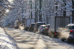 MOSCOW, FEB. 01, 2018: Winter day view on automobiles car in city hard traffic caused by heavy snow in the city. Slow cars traffic. Jam. Jammed traffic on snow royalty free stock image
