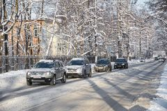 MOSCOW, FEB. 01, 2018: Winter day view on automobiles car in city hard traffic caused by heavy snow in the city. Slow cars traffic. Jam. Jammed traffic on snow stock photo