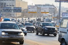 MOSCOW, FEB. 01, 2018: Winter day view on automobiles car in city hard traffic caused by heavy snow in the city. Slow cars traffic. MOSCOW, FEB. 01, 2018: Winter stock photos