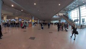 Passengers walking in departure hall at Domodedovo international airport. stock video footage